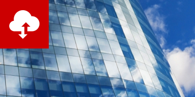 Glass skyscraper reflects the clouds in the sky